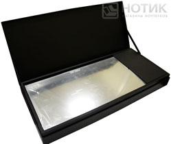 Ноутбук ASUS NX90Jq: открытый футляр с ноутбуком и комплектацией