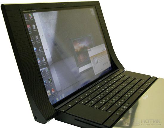 Ноутбук ASUS NX90Jq: включенный экран, вид сбоку