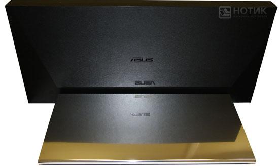 Ноутбук ASUS NX90Jq закрытый рядом с футляром
